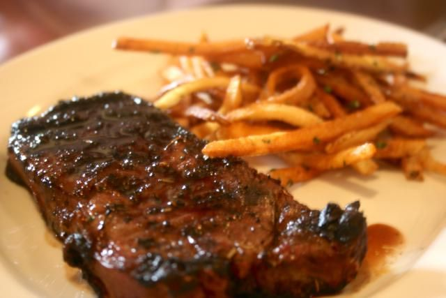 French and Belgian bistro classic recipe for pan-sautéed rib-eye steak with garlic French fries