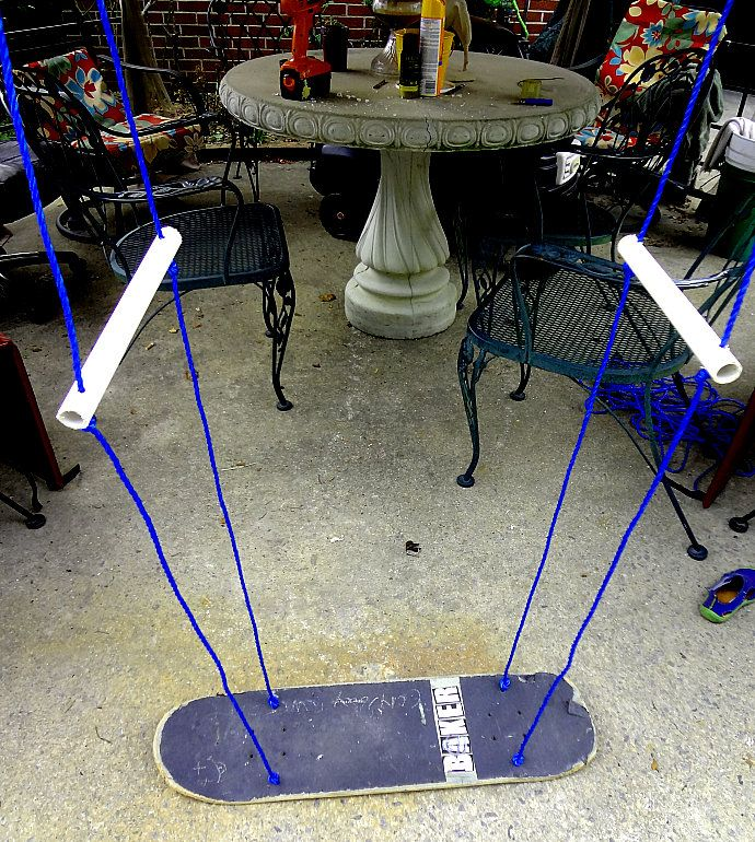 Check out this awesome stand up diy upcycled skateboard deck turned swing!