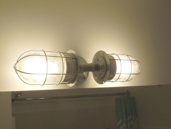 vanity cage light  https://www.etsy.com/listing/125028034/plumb-good-cage-plumbing-vanity?