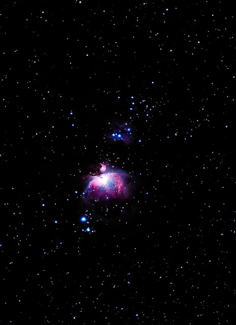The Orion Nebula complex is undoubtedly one of the most famous and beautiful areas of the entire night sky. It is easily visible to the unaided eye from a dark location as a patch of brightness surrounding Theta Orionis, the middle star in the sword of Orion the Hunter, the constellation which dominates the winter night sky.    Located about 1,350 light years away, the nebula glows red predominantly from the light of hydrogen gas excited by energetic newly formed stars in the heart of the…