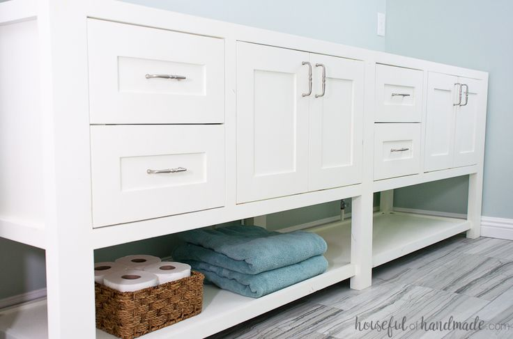 An open shelf bathroom vanity with large drawers for lots of storage. Easy to build mission style doors add farmhouse character. Plans for a single vanity, with notes to make a double vanity as well.
