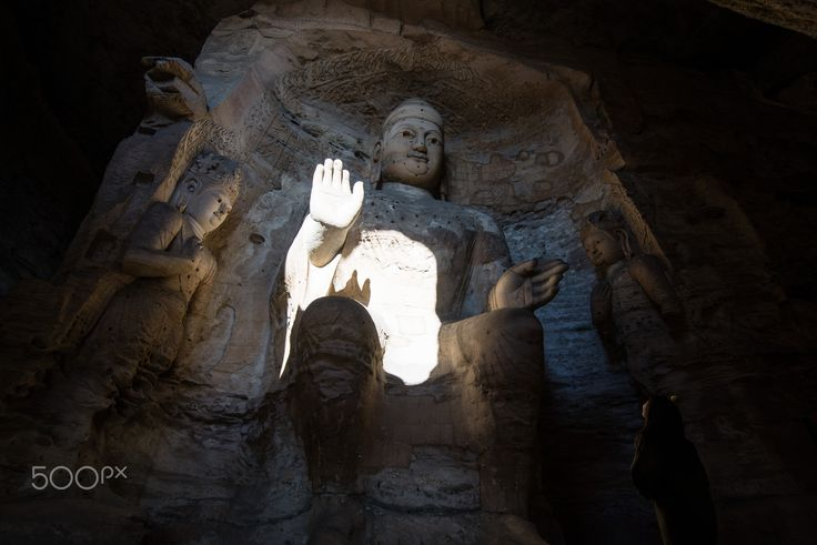 Touched - Big buddha inside cave in Yungang, Shanxi province, China