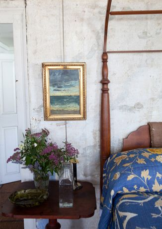 Fresh flowers, Indian-inspired John Robshaw bedding, a vintage carafe and water glass, a Cire Trudon candle, and art by friends like Hugo Guinness await guests in their rooms.  PHOTOGRAPH BY Cedric Angeles