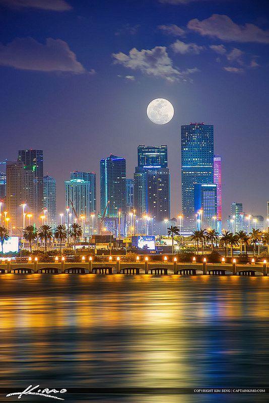 Miami City Skyline Moon Setting Behind Buildings
