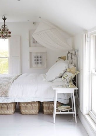 Love the basket storage under the bed and the painted white floors so clean and fresh-could also work as a guest bedroom!