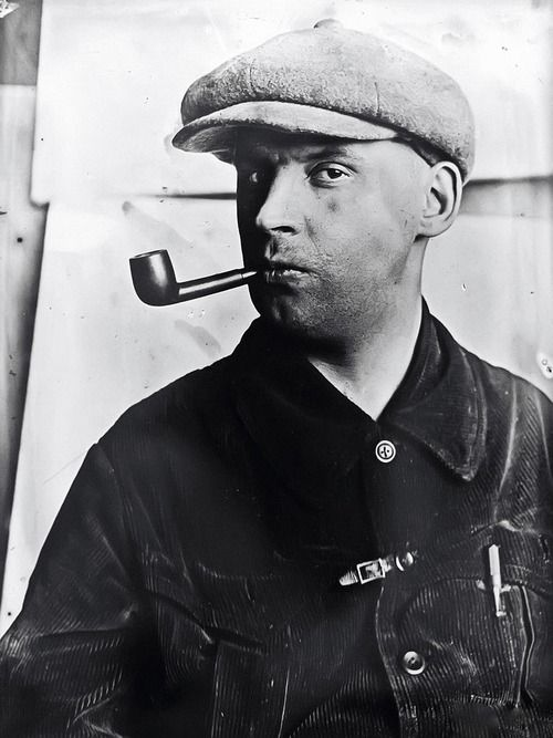 USSR. Russian Constructivist artist Alexander Rodchenko with a pipe, 1924 // by Varvara Stepanova