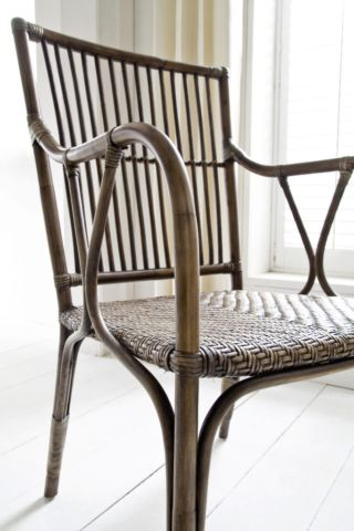 This woven rattan chair is a bit of a go-anywhere piece and will work just as well as an office chair, a dressing chair, a dining chair or simply just an accent piece in any room. It's all thanks to its slim profile and light lines that ensure it will never be obtrusive nor appear heavy on the eye.
