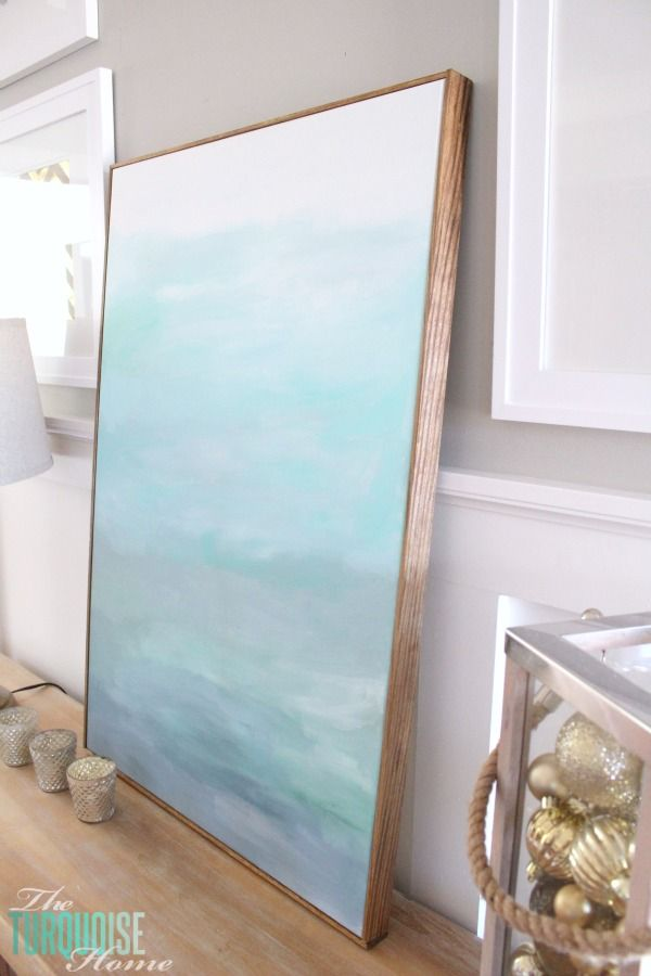 This easy DIY tutorial will teach you how to frame a canvas for cheap, making a huge piece of $22 art look like it's worth much more!