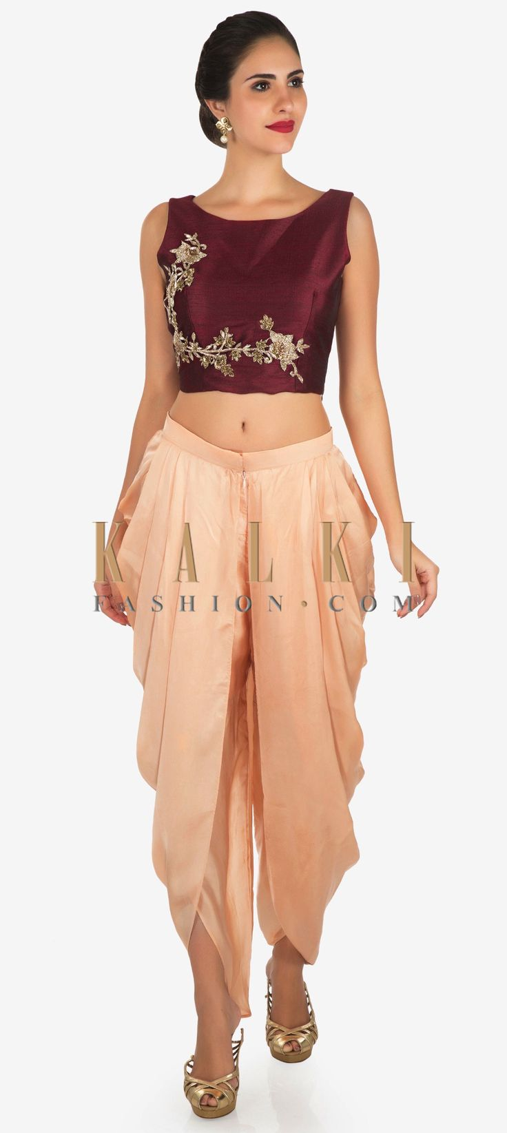 Buy Online from the link below. We ship worldwide Click Anywhere to Tag Peach and maroon dhoti suit enhanced in zardosi embroidered work only on Kalki  Dance away the night at your besties sangeet ceremony in this dhoti suit. The crop top in raw silk is featured in maroon. It is intricately constructed using the zardosi floral motif embroidery work. Matched with a peach dhoti in satin with a front zip opening. Slight variation in color is possible.