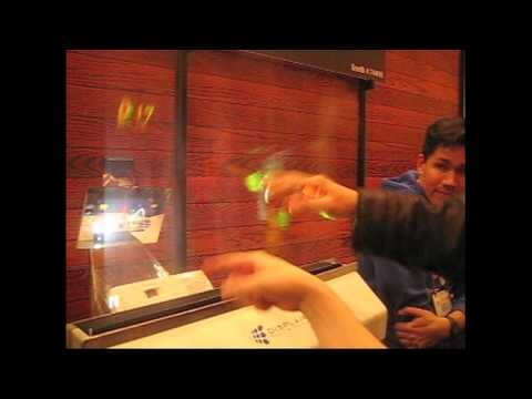 """The Displair is a virtual touch-screen display, which is made out of water vapor. You can use it as you would any touchscreen (there's a sensor behind it). Here, you can see people playing the popular mobile game, """"Fruit Ninja."""" The company plans to release the virtual screen sometime this year for about $15,000."""