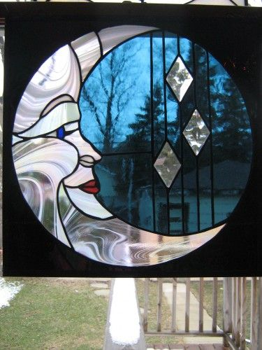 Stained glass moon with sky and stars surrounding it-this would really be neat with a full moon shinning through!