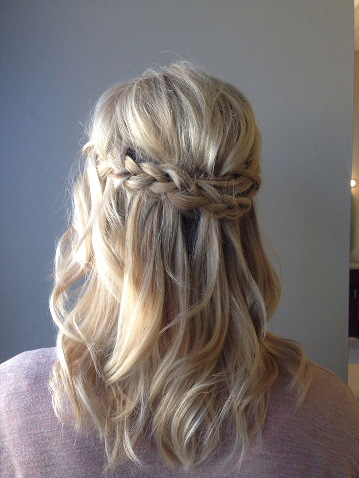 Wavy blonde curls with loose waterfall braid. Perfect summer style for medium length hair. So much texture for such a simple style.