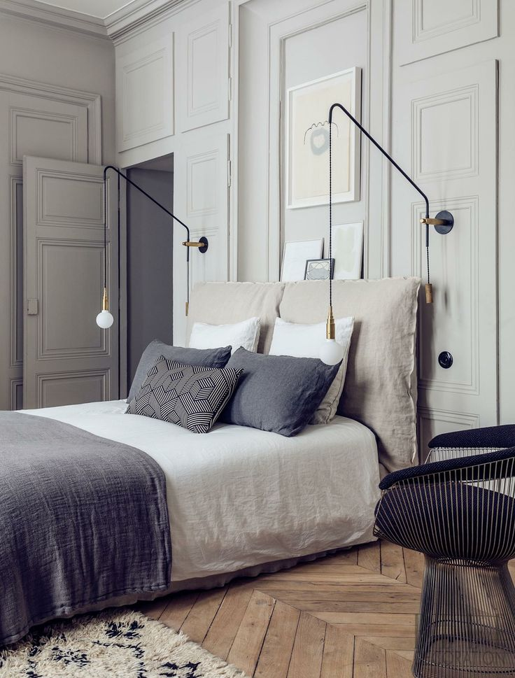 Neutral linens, weathered wood floor panelled walls, modern wall light fittings