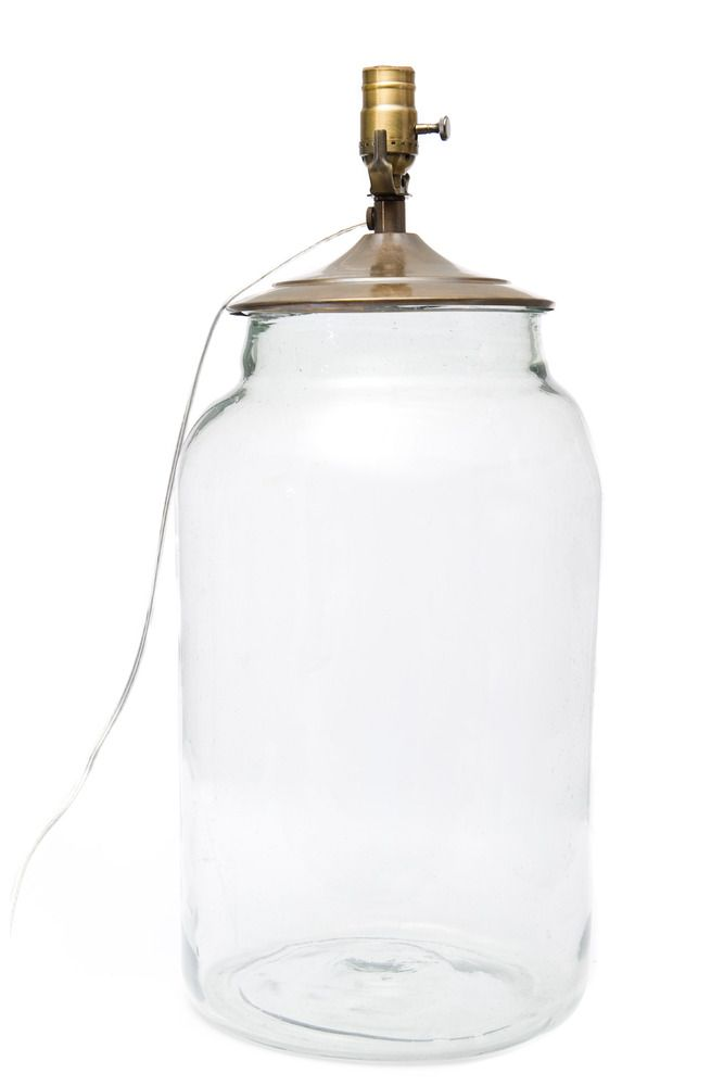 """Our recycled glass mason jars have been converted into stunning table lamps. For a truly authentic look, pair with our grain sack fabric lamp shades. We recommend the small 16"""" shade for this particular lamp. Each piece is UL certified. Choose from green, cobalt, clear or amber."""