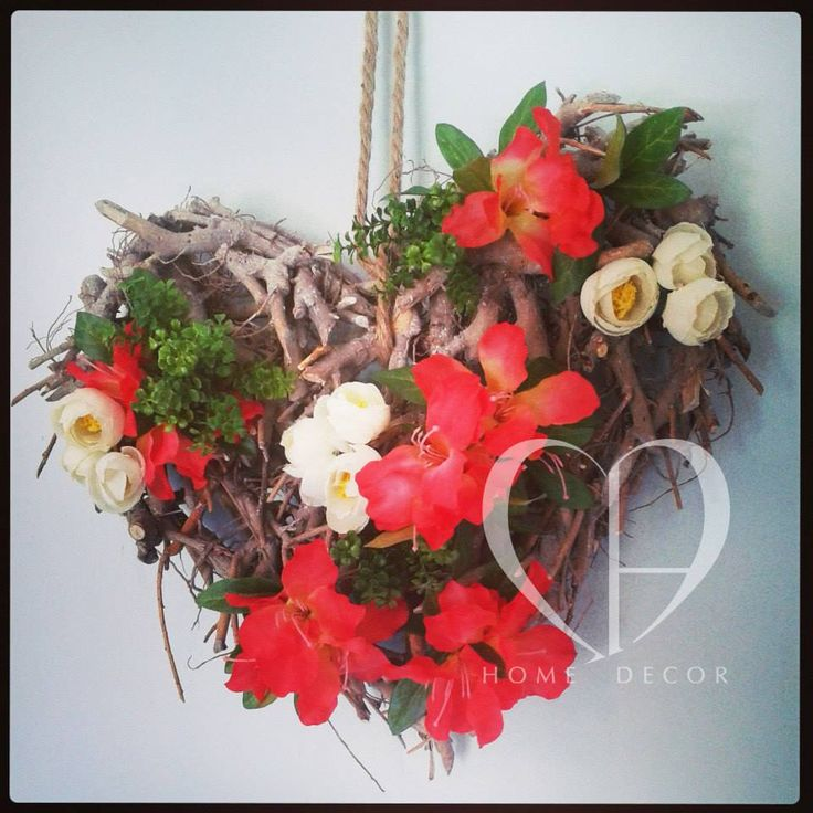 heart with twisted branches,azaleas coral-colored and anemones