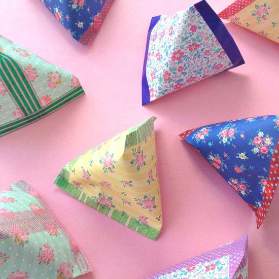 Transform origami paper and washi tape into these adorable pyramid pouches with just a few clever folds.
