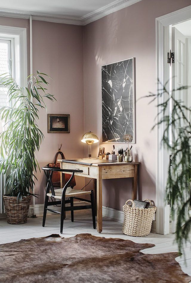 Pink walls and traditional desk.
