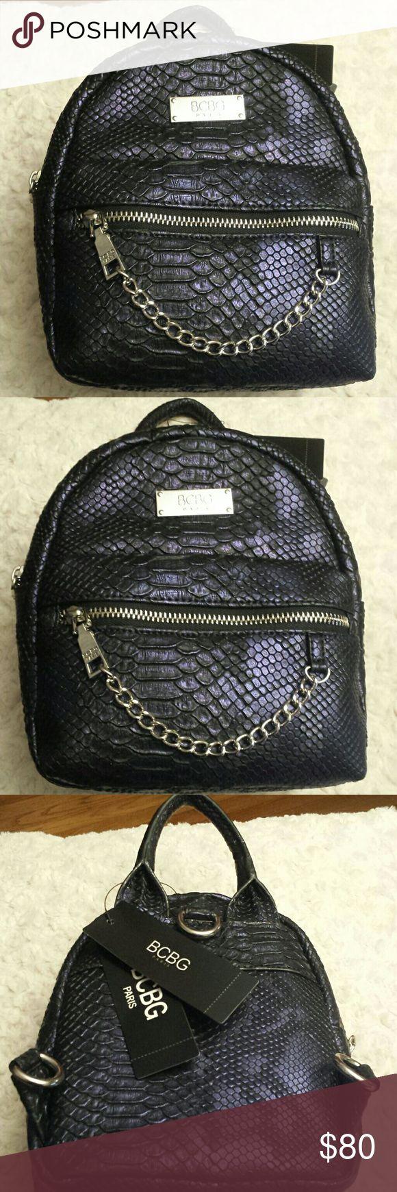 BCBG NWT Purple Metallic Petite Backpack NWT BCBG Metallic Purple Main Street Petite Backpack,  Straps inside,  Zip pocket outside and Slip Pocket inside BCBG  Bags Backpacks