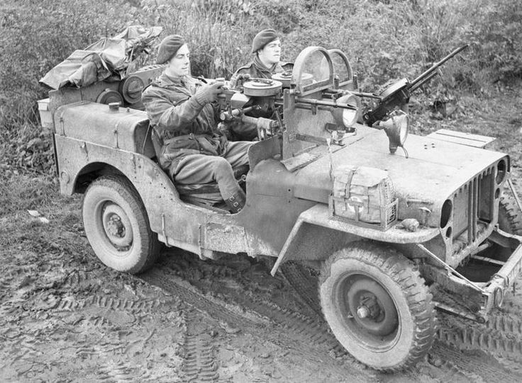 An SAS Willys MB Jeep 4x4 manned by Sergeant Schofield and Trooper Jeavons of 1st SAS near Geilenkirchen, Germany: November, 18 1944. The jeep is armed with three Vickers 'K' guns, and fitted with armored glass shields in place of a windscreen. The SAS were involved at this time in clearing snipers in the 43rd Wessex Division area.