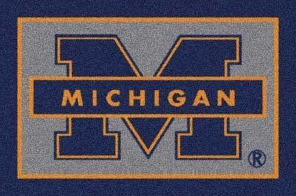 """Michigan Wolverines 22"""" x 33"""" Team Door Mat by Milliken. $55.26. Get in the game...with an NCAA Michigan Wolverines Team Mat!Durability: Made of 100% nylon fiber, Team Mats are the most durable on the market.Washable: Even after repeated washings Team Mats never fade and stay the same shade.Safety: Patented non-skid backing assures that Team Mats will stay where you put them.Please allow 3-4 weeks for shipping."""