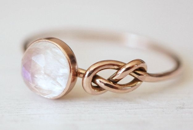 A lovely rainbow moonstone ring that will knot let you down. | 31 Stunning Engagement Rings That Aren't Made With Diamonds