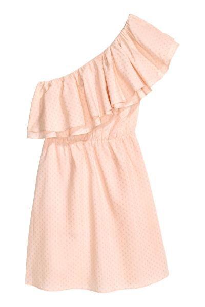 Vestido de un hombro: Vestido corto en tejido de algodón con textura. Modelo de un hombro con capa doble en el cuerpo, volantes en el escote, elástico en la cintura y falda forrada.