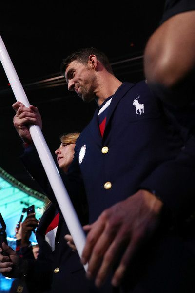 Michael Phelps Photos Photos - Flag bearer Michael Phelps of the United States is seen during the Opening Ceremony of the Rio 2016 Olympic Games at Maracana Stadium on August 5, 2016 in Rio de Janeiro, Brazil. - Opening Ceremony 2016 Olympic Games - Olympics: Day 0
