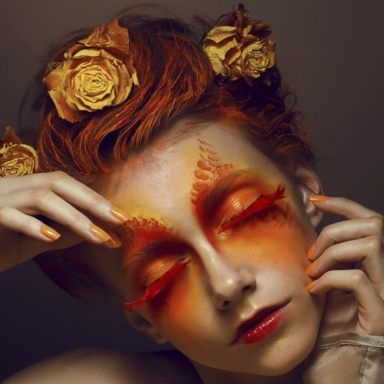 Avant-garde Eye Makeup with Orange and Red Eyeshadow and Lashes