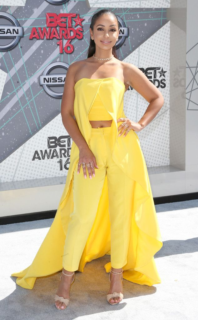 Mya from BET Awards 2016 Red Carpet Arrivals  Is it a pantsuit, a dress, cape? Who cares! The singer looks absolutely phenomenal in in this yellow ensemble.