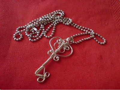 little key... silver wire, dab of heart and few moments with pliers