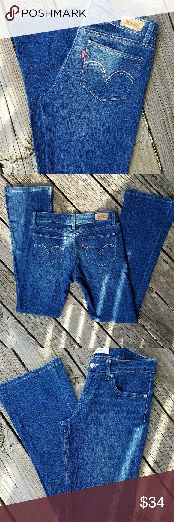"""Levis Super Low Rise Jeans Levis Super Low Rise Jeans Size 7 Long  Waist 28"""" Length 34""""  Boot Cut  Like New Condition Levis Jeans Boot Cut"""