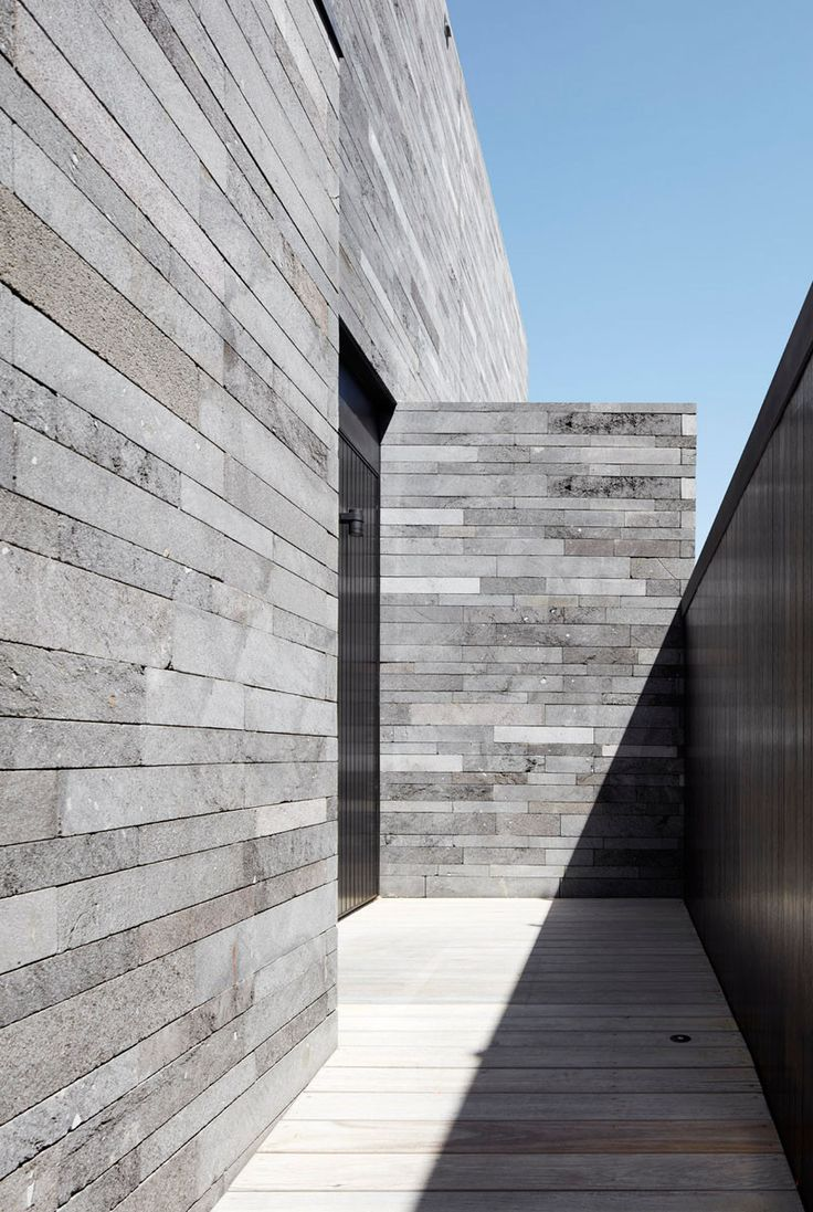 Adam architecture groundbreaking country house in hampshire - Design Detail Lava Stone Is Used To Create A Natural Look For This Home