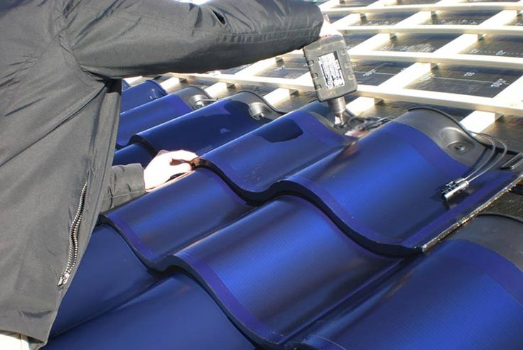 Photovoltaic roof tiles. Love this shape! Much more organic than a straight roof.