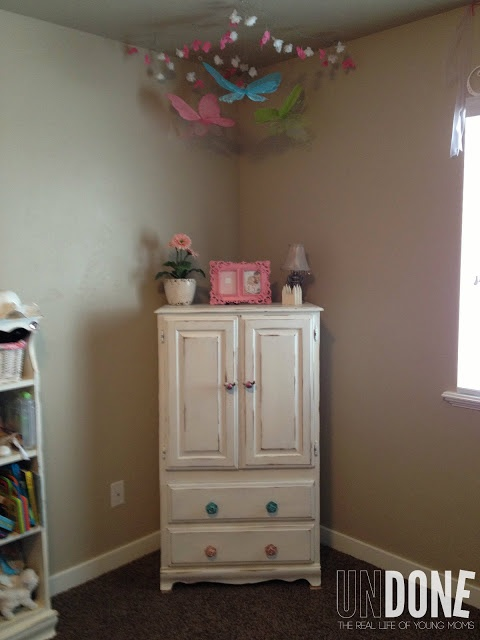 Amour made of out of a tv stand! So cute for a little girls room!