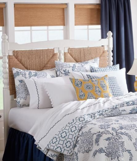 A multi-toned blue floral print is displayed on this white cotton quilt and shams set. Reverses to an intricate geometric pattern. (Country Curtains Pierce Cotton Quilt Set)