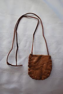 How to make a Leather pouch necklace   here: http://blackcatcraft.blogspot.com/2012/11/leather-pouch-necklace.html