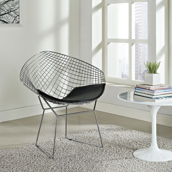 CAD Lounge Chair, Black - A modern club chair broken down to the most basic of its elements, suitable for home or office, this contemporary accent chair is a remarkable piece. The continuous wire-like seat is visually stimulating, and a black leather-matched vinyl seat pad is included for comfort. A simple yet stylish design in a geometric shape. Set Includes: One - CAD Diamond Wire Chair. Material: Base-aluminum, Pad-vinyl, Seat-PVC. Weight: 75. Assembly Required