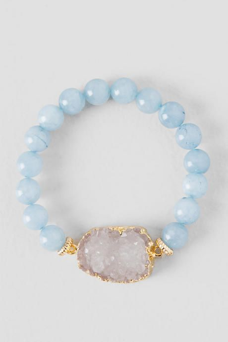 The simple Seminole Stretch Bracelet is a perfect way to show off your sophisticated style. This stretch style bracelet features periwinkle glass beads & a large druzy stone set in a hammered gold setting.