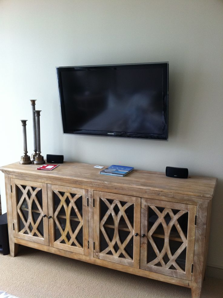 I like the look of the longer cabinet beneath the wall mounted TV.
