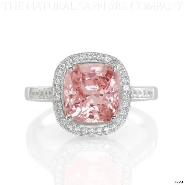 Natural Padparadscha sapphire pave ring. Padparadscha sapphires are the rarest of all sapphires.