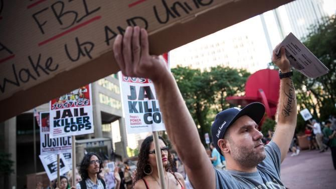 Protesters hold a rally Aug. 18, 2014, in New York City in solidarity with the people of Ferguson, Mo., protesting the death of Michael Brown and the excessive use of force by police.