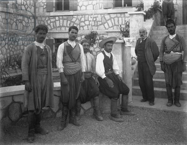 Sir Arthur Evans hired a Swiss artist, Emile Gilliéron (1850–1924) and later his son, Emile (1885–1939), as chief fresco restorers at Knossos, where they worked for more than thirty years. Gillieron pere standing on the steps of the Villa Ariadne; Manolaki sites on the balustrade wearing a wide-brimmed hat.'