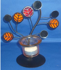 Decorative Black Tree Tea Lite Holder from Absolute Angels Black Tea Lite holder with decorative orange red black and mirrored discs Comes complete with tea lite candle ready for use Approx 19cm tall 17cm £2.99