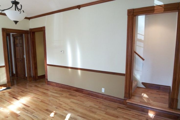 Entry way - original wood work, chair rail and entry to Kitchen,
