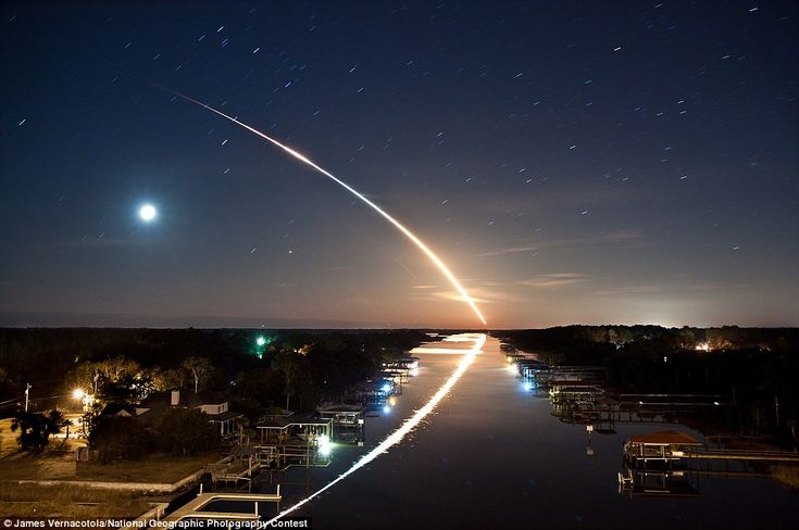 Soaring ::  Waterway to Orbit, by James Vernacotola, displays the Space shuttle Endeavour flying into orbit over the Intracoastal Waterway in Ponte Vedra, Florida