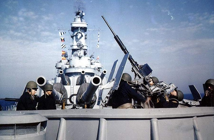 20mm Oerlikon cannon crew engaged in anti-aircraft exercise aboard USS Iowa, May 1943.