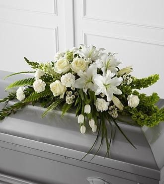 The FTD® Resurrection™ Casket Spray inspires thoughts of comfort and peace to those wishing to pay their respects for the loss of the deceased. White tulips, roses, snapdragons, Oriental lilies, larks