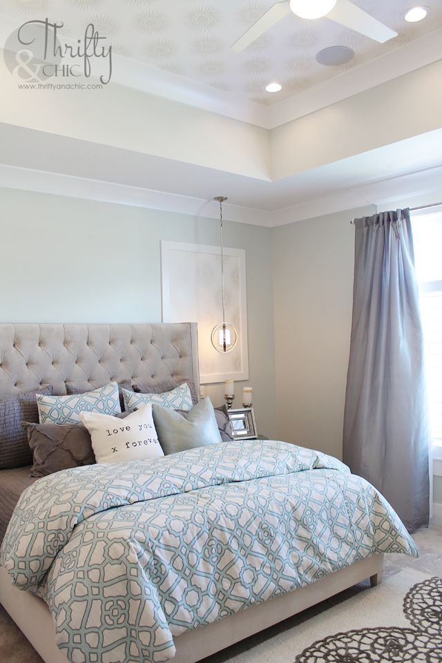 Soothing paint colors of blue and grey for this master bedroom.