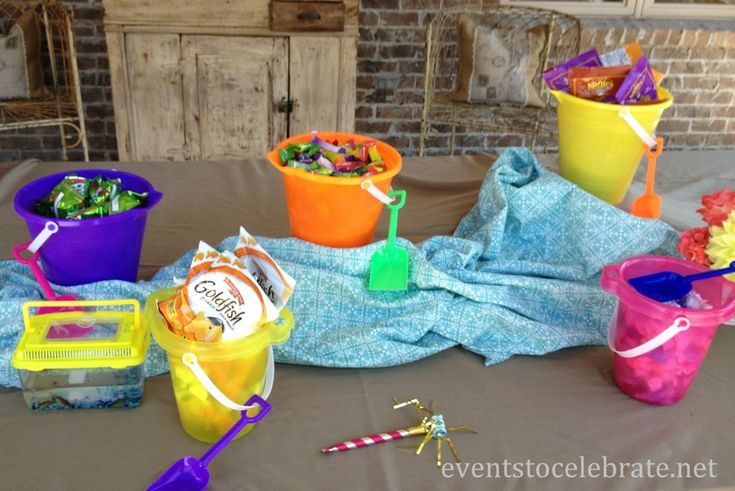 Swim Party Decorations - treats in sand buckets like: gummy sharks, gummy worms, salt water taffy and gold fish crackers