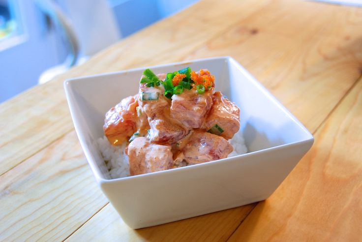 Get a taste of Hawaiian cuisine with a staple dish - Spicy Ahi Poke. Cubes of ahi are coated in a sriracha-mayo sauce and served over a bed of Mahatma white rice.